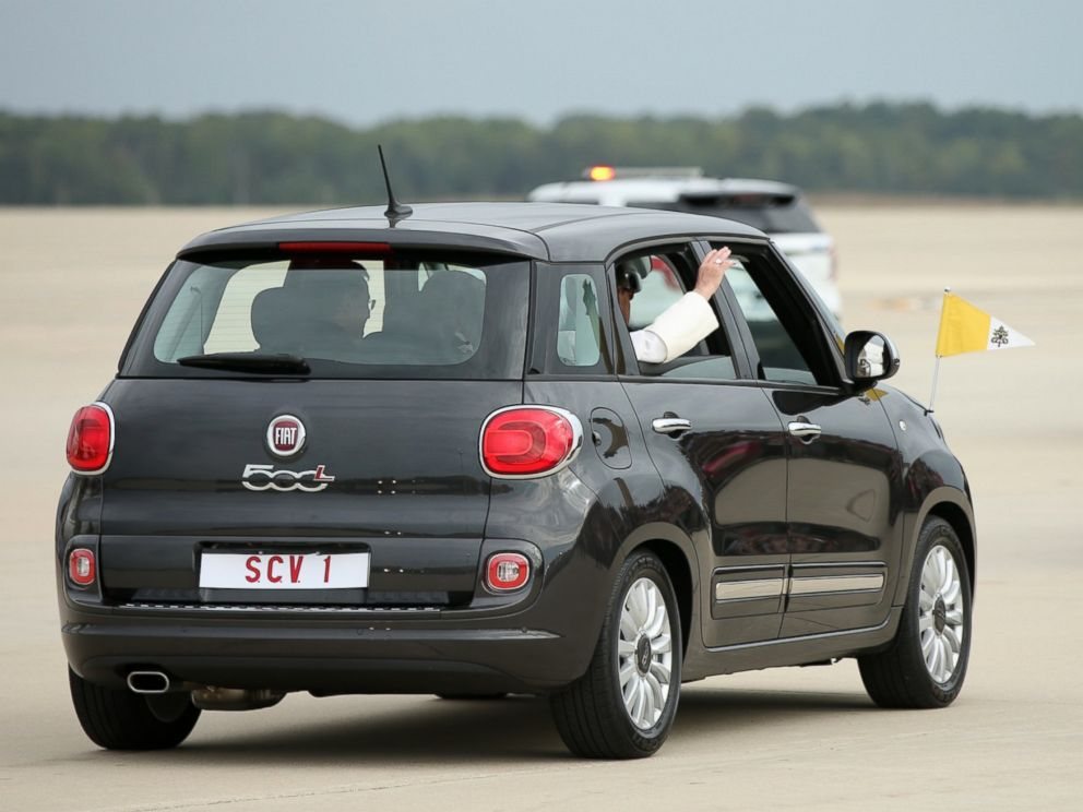 PHOTO: Pope Francis waves from a Fiat 500 as his motorcade departs from Andrews Air Force Base, Md., Sept. 22, 2015, where President and Mrs. Obama welcomed him.