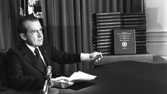 PHOTO: President Nixon gestures toward transcripts of White House tapes after announcing he would turn them over to House impeachment investigators and make them public in April of 1974.