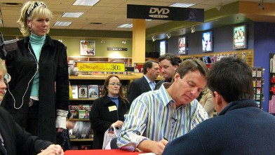 "PHOTO: Rielle Hunter, left, watches John Edwards, right, as he autographs a copy of his book, ""Home: The Blueprints of Our Lives"" during a campaign stop in Dallas, Dec. 1, 2006."