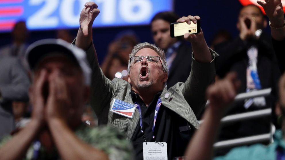 People react to Sen. Ted Cruz during his address on the third day session of the Republican National Convention in Cleveland, July 20, 2016.