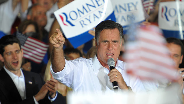PHOTO:In this photo provided by the U.S. Coast Guard, Republican Presidential candidate Mitt Romney, right, speaks during a campaign rally in Manassas, Va., Saturday, Aug. 11, 2012.