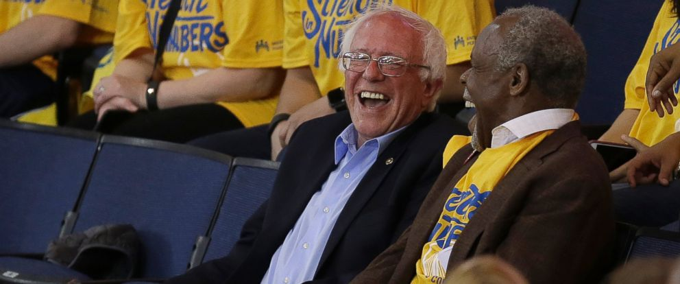 PHOTO: Democratic presidential candidate Bernie Sanders, left, laughs with Danny Glover during Game 7 of the NBA basketball Western Conference finals between the Golden State Warriors and the Oklahoma City Thunder in Oakland, Calif., Monday, May 30, 2016.