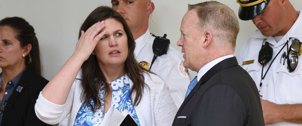 PHOTO: Outgoing press Secretary Sean Spicer talks with Principal Deputy Press Secretary Sarah Sanders during a press conference in the Rose Garden of the White House on July 25, 2017 in Washington, DC.