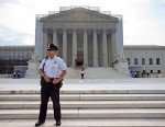 PHOTO: A police officer keeps watch outside the Supreme Court in Washington, June 17, 2013.