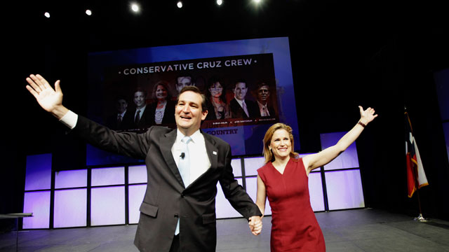 PHOTO: U.S. Senate Candidate Ted Cruz, left, and his wife Heidi Cruz wave as they take the stage during the Texas Republican Convention in Fort Worth, Texas, June 9, 2012.