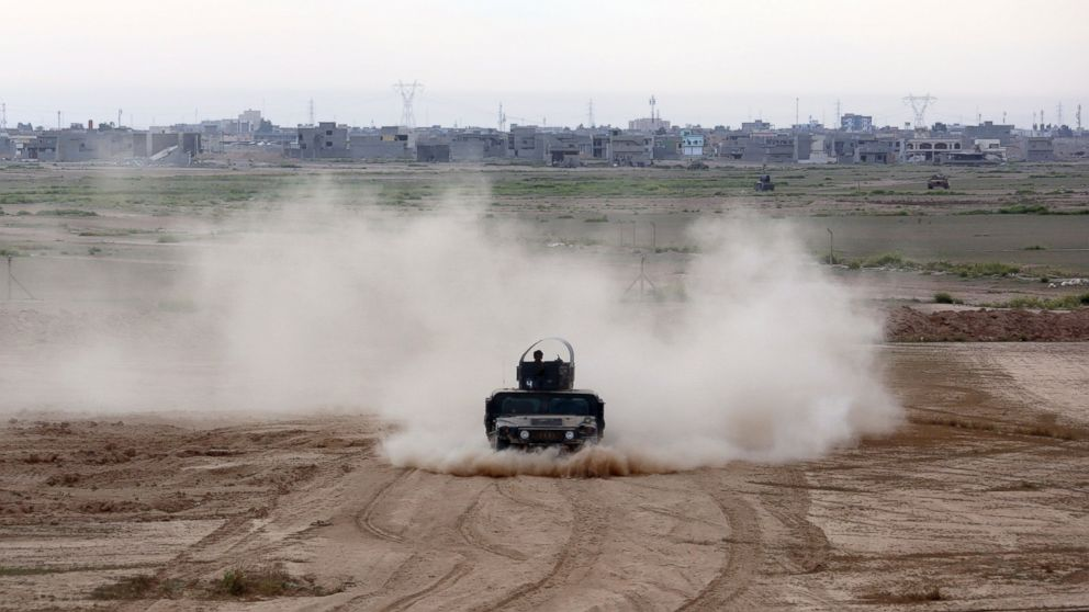 Iraqi Army armored vehicles prepare to attack Islamic State extremists in Tikrit, north of Baghdad, Iraq, March 12, 2015.