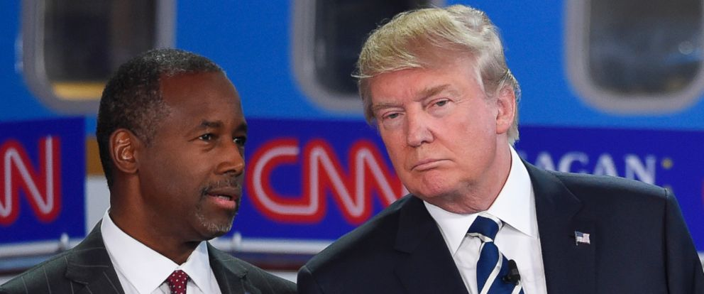PHOTO: Republican presidential candidates Ben Carson, left, and Donald Trump talk before the start of the CNN Republican presidential debate at the Ronald Reagan Presidential Library and Museum, Sept. 16, 2015, in Simi Valley, Calif.