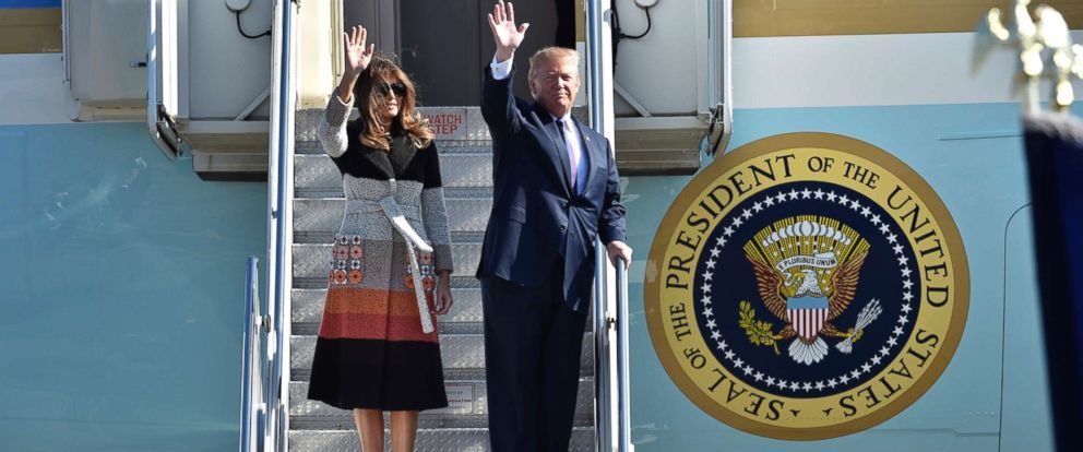PHOTO: President Donald Trump, right, and first lady Melania Trump, left, wave on their arrival at the U.S. Yokota Air Base, on the outskirts of Tokyo, Sunday, Nov. 5, 2017.