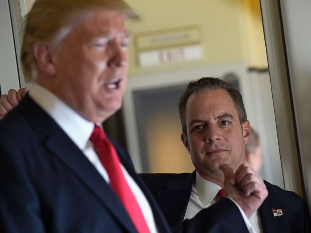 PHOTO: Then-White House Chief of Staff Reince Priebus listens at right as President Donald <script type=