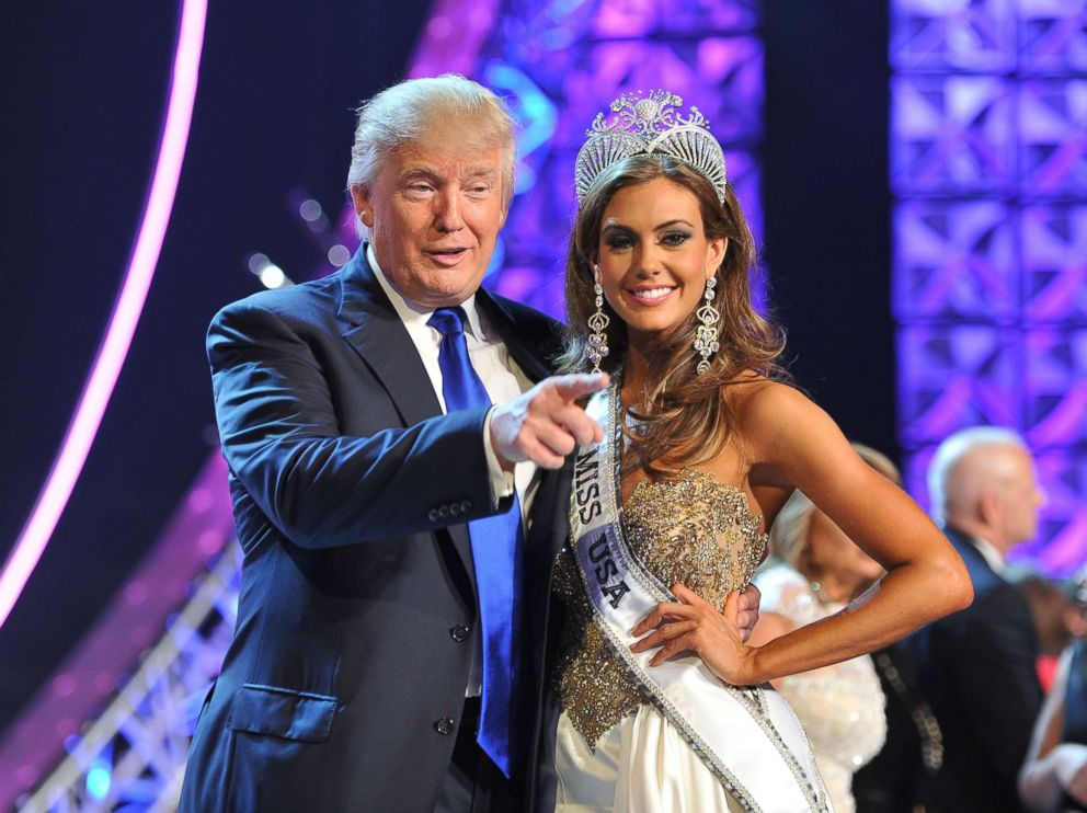 In this June 16, 2013 file photo, Donald Trump and Miss Connecticut USA Erin Brady pose onstage after Brady won the 2013 Miss USA pageant in Las Vegas.