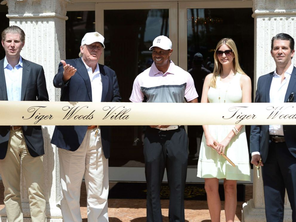 PHOTO: Eric Trump, Donald Trump, Tiger Woods, Ivanka Trump and Donald Trump Jr. at the Tiger Woods Villa prior to the start of the World Golf Championships-Cadillac Championship at Trump National Doral on March 5, 2014 in Doral, Florida.