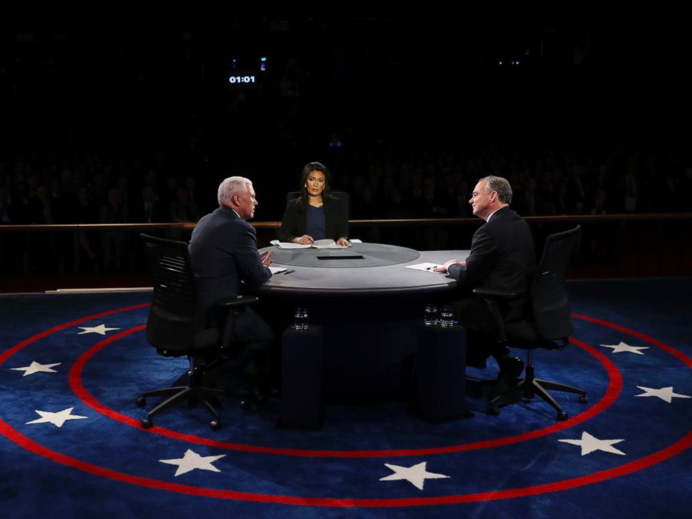 PHOTO: Republican vice-presidential nominee Gov. Mike Pence and Democratic vice-presidential nominee Sen. Tim Kaine discuss as Moderator Elaine Quijano listens during the vice-presidential debate at Longwood University in Farmville, Va., Oct. 4, 2016.