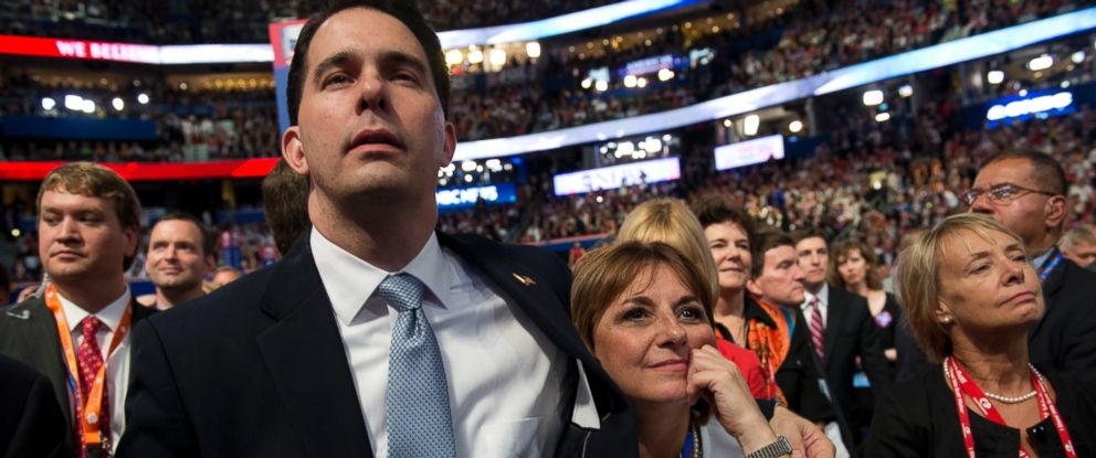 PHOTO: Gov. Scott Walker, R-Wisc., and First Lady Tonette Walker, listen to Mitt Romney, republican presidential nominee, address the Republican National Convention in Tampa, Fla.