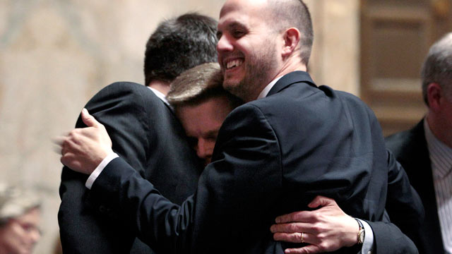 PHOTO: Rep. Jamie Pedersen, D-Seattle, center, is congratulated after the House voted to legalize gay marriage in Washington state on Feb. 8, 2012, in Olympia, Wash.