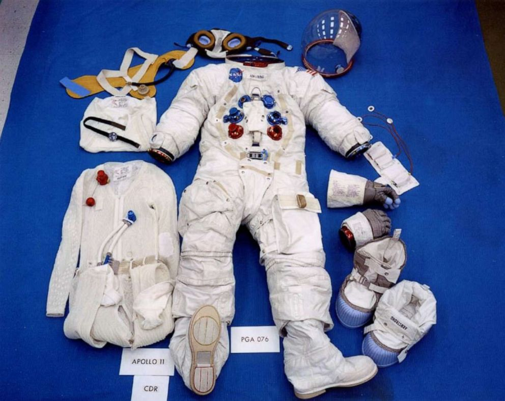 PHOTO: This pre-flight photo shows Neils suit in its lunar surface configuration, which includes the Liquid Cooled Garment at the left and the EVA (Extra-vehicular) gloves and moon boots at the right.