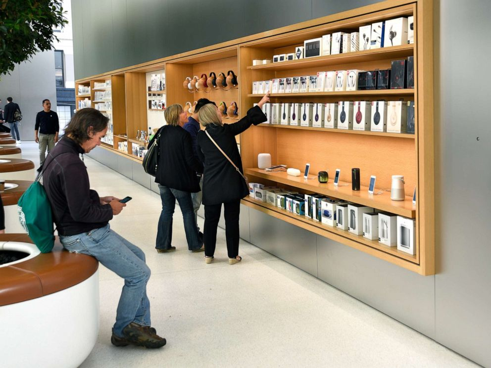 PHOTO: In this Sept. 12, 2018 file photo, customers shop for accessories at the Apple Store in San Francisco.