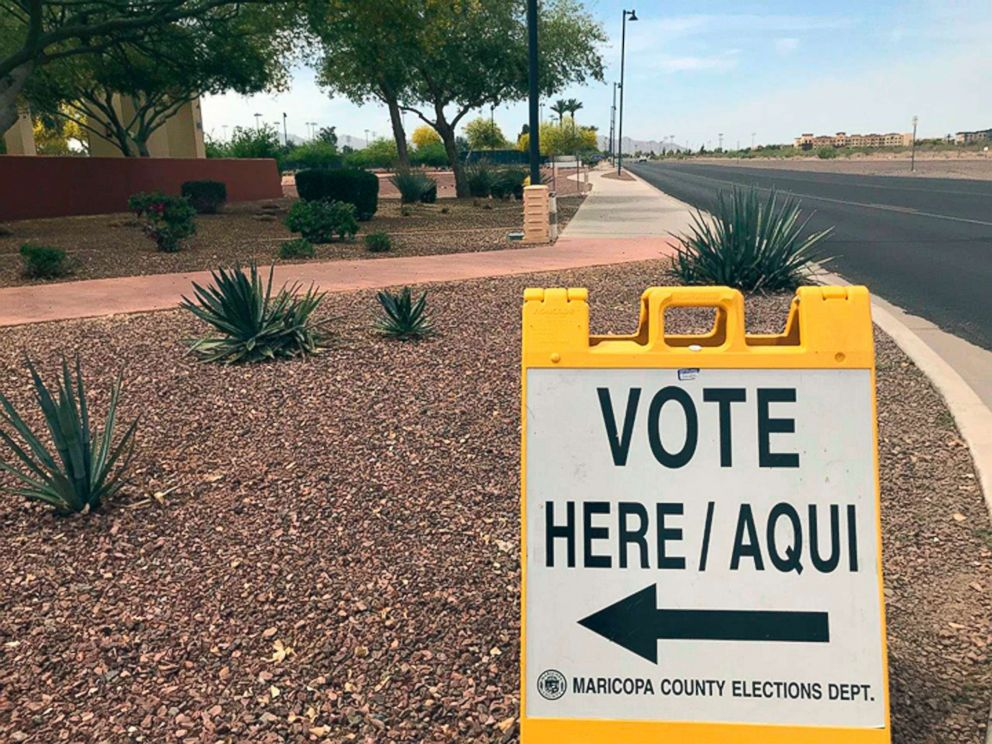 PHOTO: A sign directing voters to an early-voting location in Surprise, Ariz., April 11, 2018.