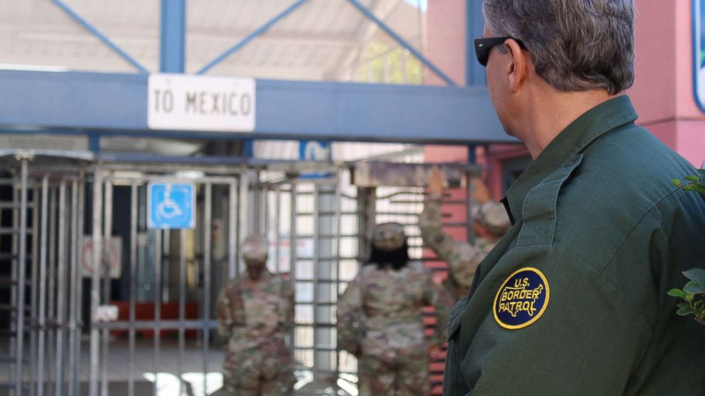 A U.S. Customs and Border Protection (CBP) agent watches while U.S. Army Engineers conduct site survey at a point of entry at the Arizona-Mexico border along the southern border of the U.S., Nov. 6, 2018.