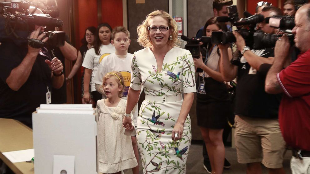 Rep. Kyrsten Sinema arrives to deliver her ballot signatures, May 29, 2018, at the Capitol in Phoenix. Sinema hopes to become the first Democrat to represent Arizona in the Senate in 30 years.