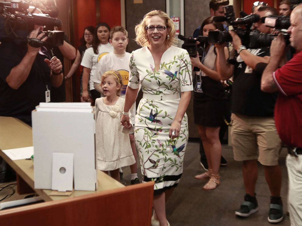 PHOTO: Rep. Kyrsten Sinema arrives to deliver her ballot signatures, May 29, 2018, at the Capitol in Phoenix. Sinema hopes to become the first Democrat to represent Arizona in the Senate in 30 years.