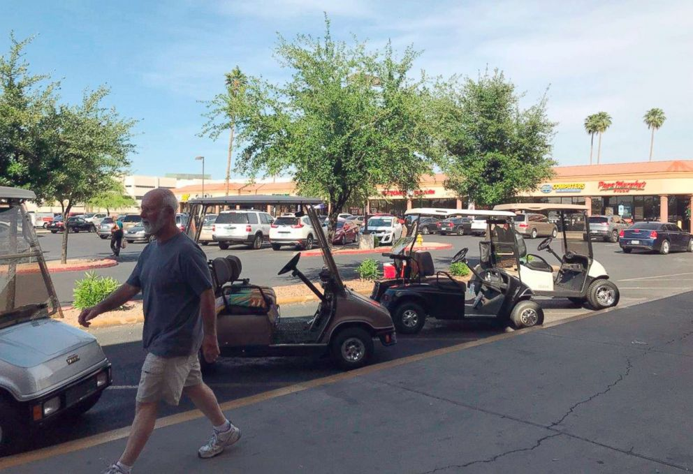 PHOTO: This April 11, 2018 photo shows golf carts at a shopping center in Sun City, Ariz. Republican Debbie Lesko, one of the candidates running for Congress here, is credited with legalizing carts for street use as a state legislator.