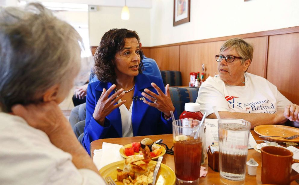 PHOTO: In this April 10, 2018, photo, Democratic candidate for the Arizona 8th Congressional District special election Dr. Hiral Tipirneni, center, talks with supporters at a local restaurant in Sun City, Ariz.