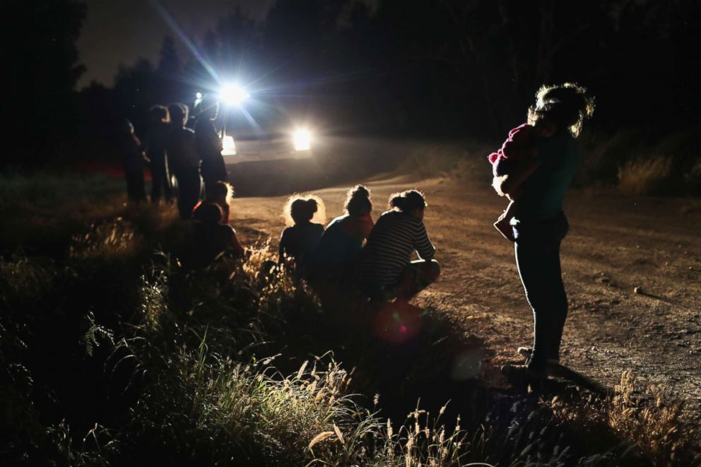 PHOTO: U.S. Border Patrol agents arrive to detain a group of Central American asylum seekers near the U.S.-Mexico border on June 12, 2018 in McAllen, Texas.