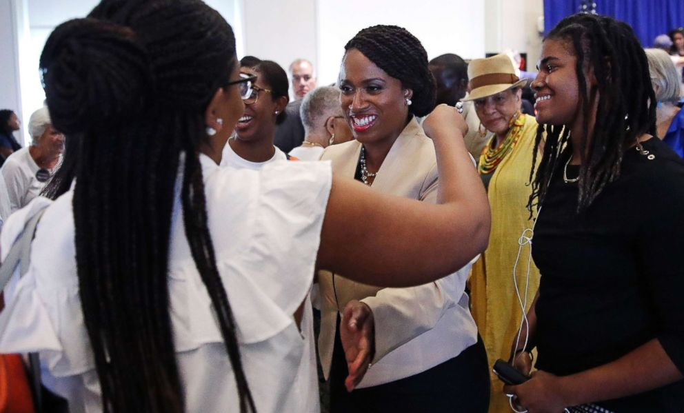 PHOTO: Boston City Councilor Ayanna Pressley, center, who is challenging Rep. Michael Capuano, is surrounded by supporters following a debate at the University of Massachusetts, in Boston, Aug. 7, 2018.