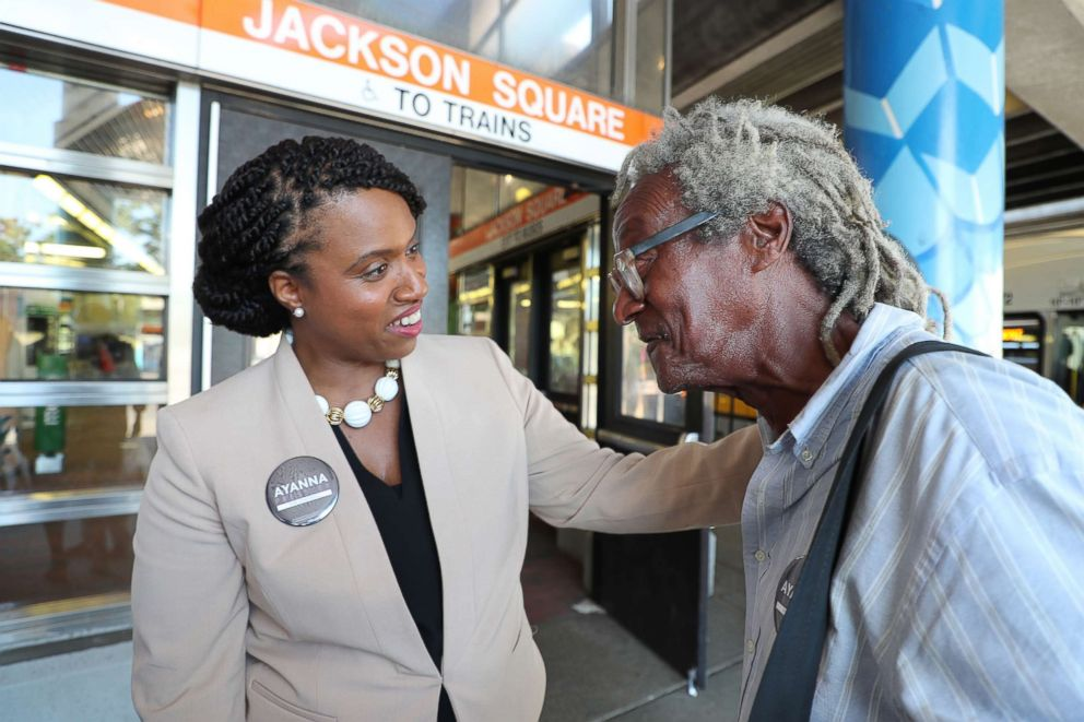 PHOTO: Boston City Councilor and congressional candidate Ayanna Pressley talks to Jeffrey McNary as she campaigns against Michael Capuano at the Jackson Square MBTA Station in the Jamaica Plain neighborhood of Boston on July 10, 2018.