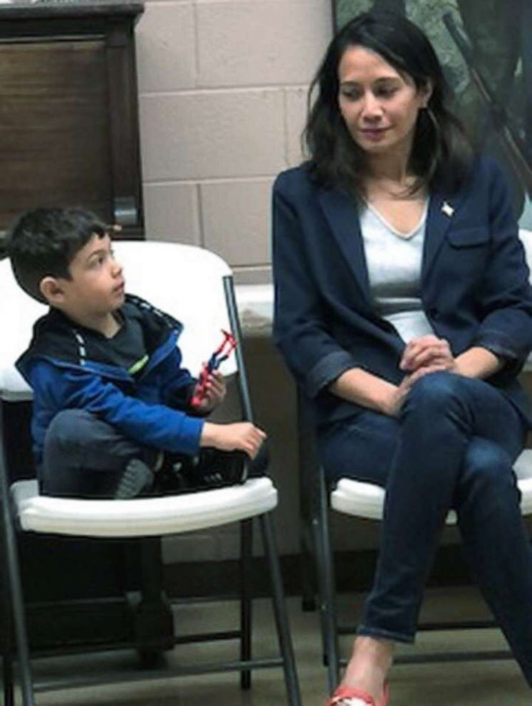 Ayne Amjad, a candidate for Congress in West Virginia, is pictured with her nephew at a meeting in Oak Hill, W.Va.
