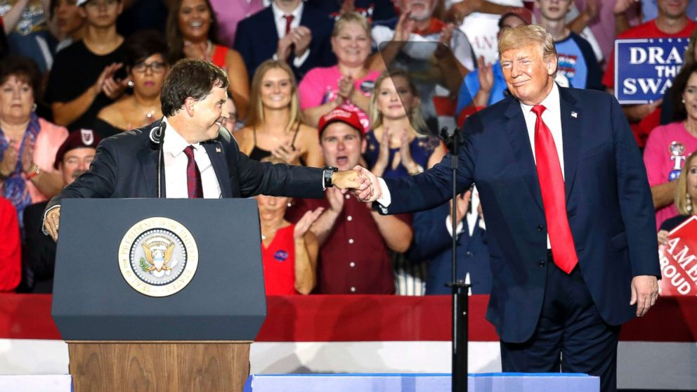 President Donald Trump, right, shakes hands with 12th Congressional District Republican candidate Troy Balderson, during a rally on Aug. 4, 2018, in Lewis Center, Ohio.