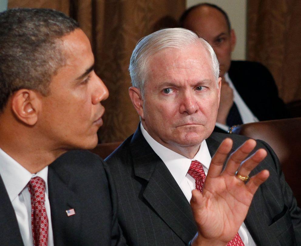 Defense Secretary Robert Gates looks on as President Barack Obama speaks in the Cabinet Room of the White House in Washington, June 22, 2010.