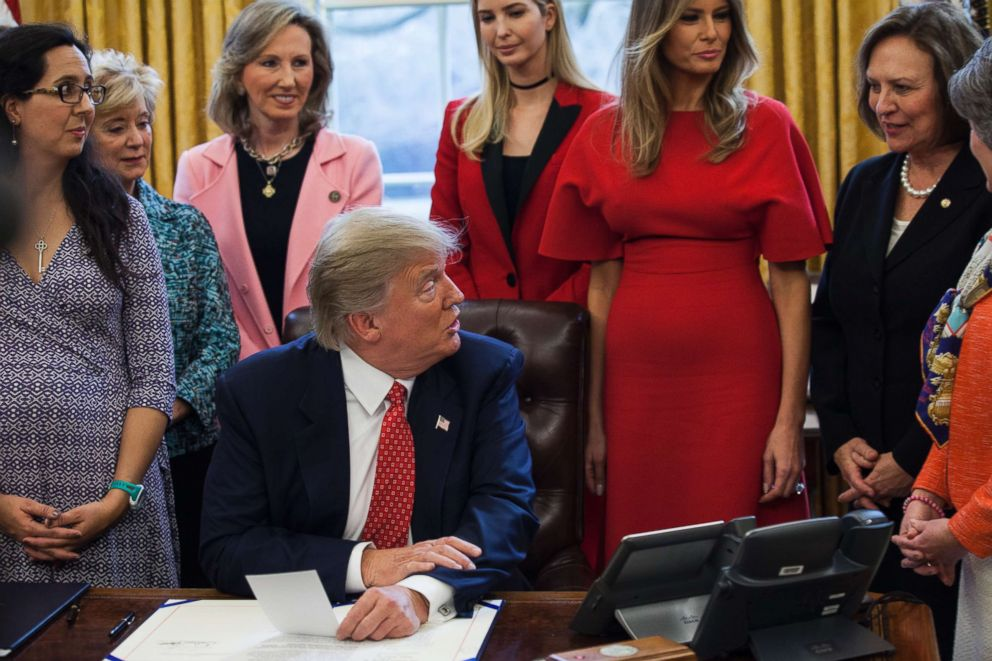 PHOTO: Rep. Barbara Comstock, third from left, watches as President Donald Trump speaks to the press before signing H.R. 321 and H.R. 255 in The Oval Office at the White House on Feb. 28, 2017 in Washington.