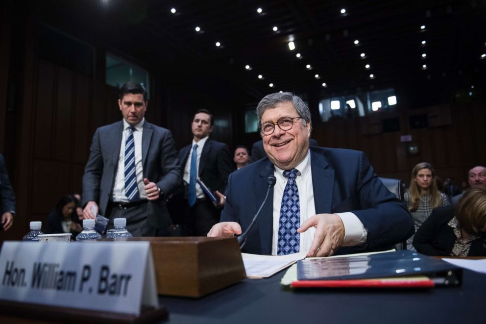 PHOTO: Assistant Attorney General Stephen Boyd, left, stands behind William P. Barr, nominee for attorney general, as Barr prepares for a break during his Senate Judiciary Committee confirmation hearing in Hart Building, Jan. 15, 2019.