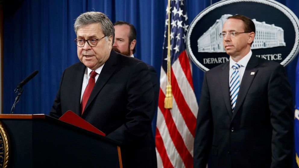 Attorney General William Barr speaks alongside Deputy Attorney General Rod Rosenstein, right, and Deputy Attorney General Ed O'Callaghan, rear left, about the release of a redacted version of special counsel Robert Mueller's report during a news conference, April 18, 2019, at the Department of Justice in Washington, D.C.