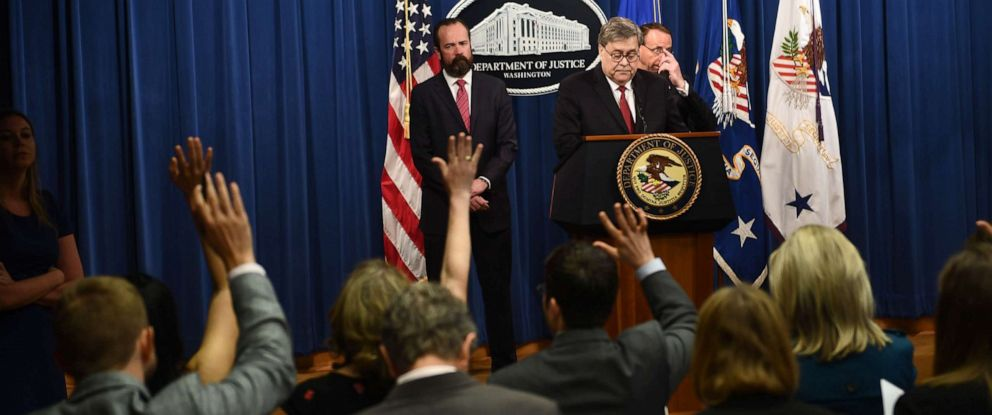 PHOTO: Members of the media raise their hands with questions as U.S. Attorney General William Barr speaks about the release of the redacted version of the Mueller report, April 18, 2019, at the Department of Justice in Washington, D.C.