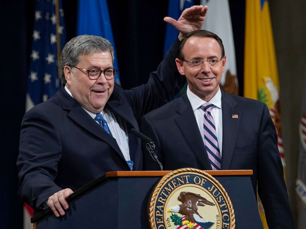 PHOTO: U.S. Attorney General William Barr gestures while making remarks with Deputy Attorney General Rod Rosenstein during a farewell event for Rosenstein at the Department Justice in Washington, D.C., May 9, 2019.