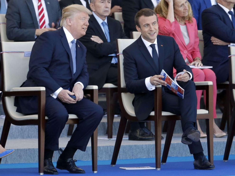 PHOTO: President Donald Trump and French President Emmanuel Macron attend the traditional Bastille day military parade on the Champs-Elysees, July 14, 2017, in Paris.