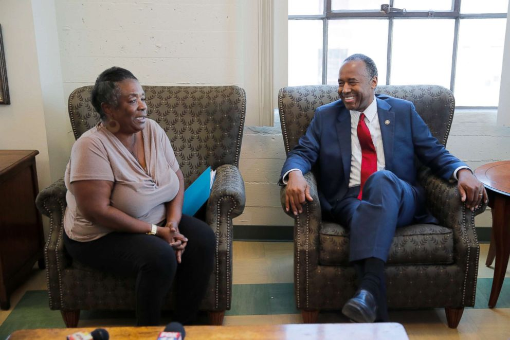 PHOTO: Housing and Urban Development Secretary Ben Carson, right, smiles while listening to Denise Smith, who used to be homeless, at the Downtown Womens Center, April 24, 2018, in Los Angeles.