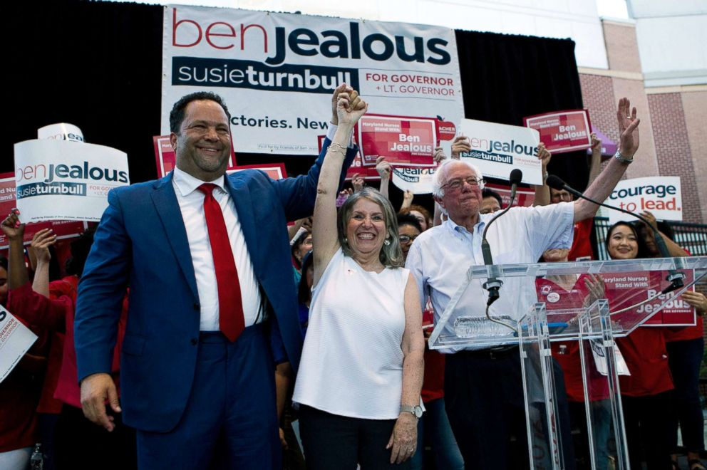 PHOTO: From left, Democrat Ben Jealous raises the hand of his running mate Susie Turnbull while Sen. Bernie Sanders waves during a gubernatorial campaign rally in Marylands Democratic primary in downtown Silver Spring, Md., June 18, 2018.