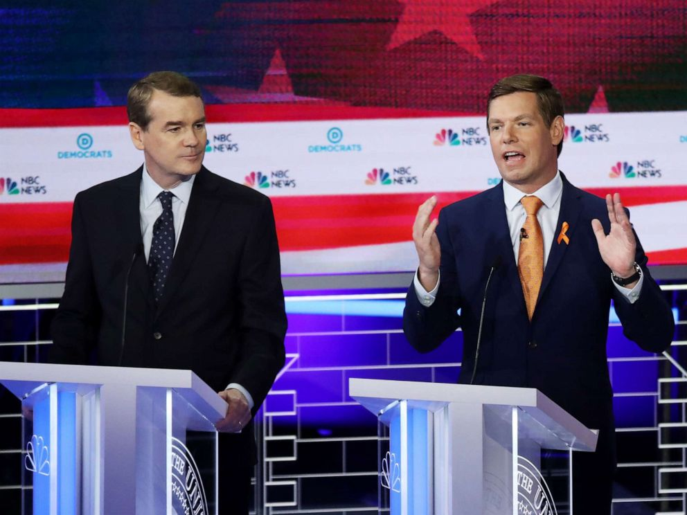 PHOTO: Michael Bennet and Eric Swalwell participate in the second night of the first 2020 democratic presidential debate at the Adrienne Arsht Center for the Performing Arts in Miami, June 27, 2019.