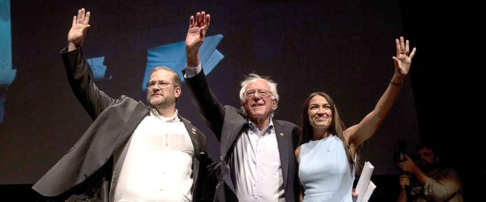 PHOTO: From right, Alexandria Ocasio-Cortez, Sen. Bernie Sanders (I-Vt.) and James Thompson, a Kansas House candidate, at a campaign event for Thompson in Wichita, July 20, 2018.