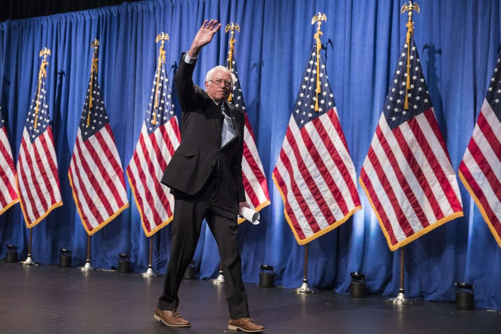 PHOTO: Democratic presidential candidate Sen. Bernie Sanders waves as he exits after delivering remarks at a campaign function in the Marvin Center at George Washington University on June 12, 2019, in Washington.