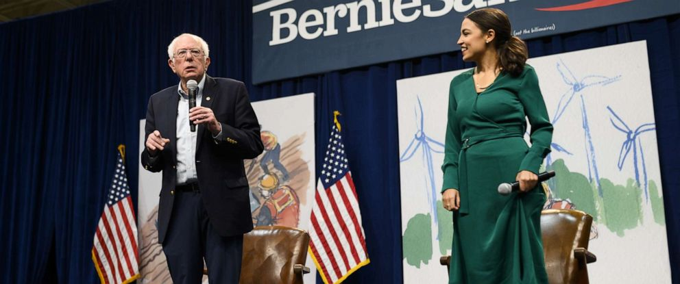 PHOTO: Sen. Bernie Sanders, I-Vt., and Rep. Alexandria Ocasio-Cortez, D-N.Y., field questions from audience members at the Climate Crisis Summit at Drake University Nov. 9, 2019 in Des Moines, Iowa.