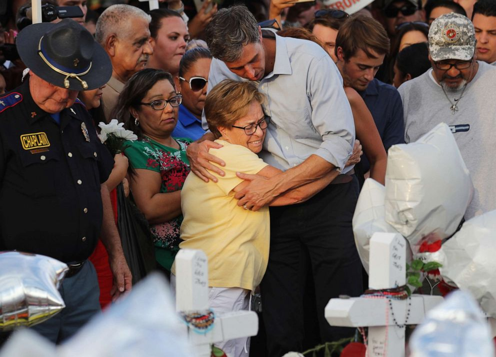 PHOTO: Democratic presidential candidate and former Rep. Beto ORourke hugs a woman at a makeshift memorial outside Walmart honoring victims of a mass shooting there which left 22 people dead, on August 7, 2019, in El Paso, Texas.