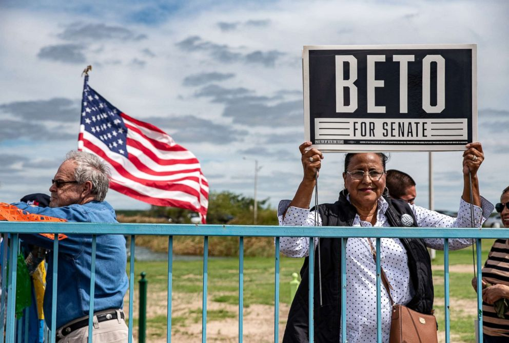 A woman holds up a sign supporting Beto O'Rourke at an event in Eagle Pass, Texas, Sept. 22, 2018.