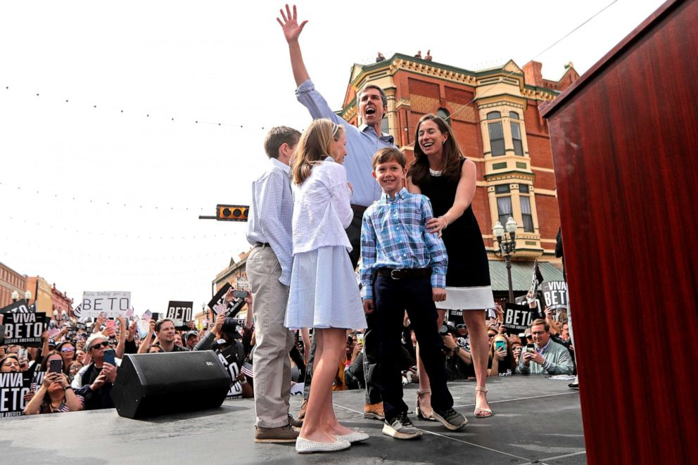 PHOTO: Democratic presidential candidate and former Texas congressman Beto ORourke acknowledges the crowd as he arrives on stage with his family at his presidential campaign kickoff in El Paso, Texas, March 30, 2019.