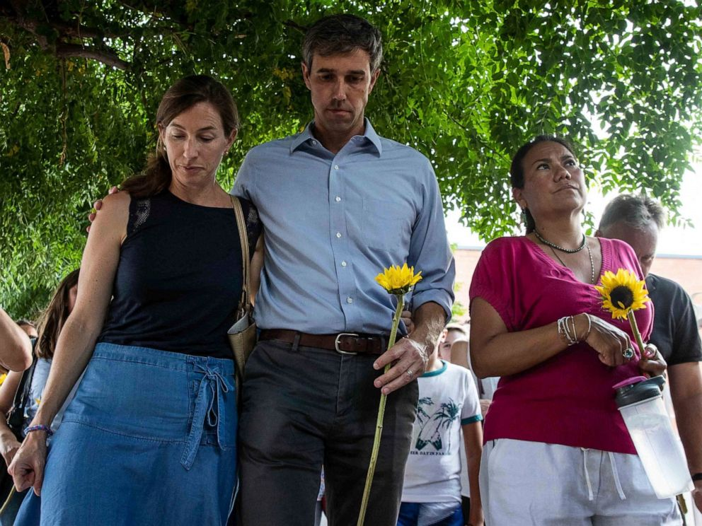 PHOTO: Democratic presidential candidate Beto ORourke walks next to his wife Amy Hoover Sanders and Rep. Veronica Escobar Sunday, Aug. 4, 2019.