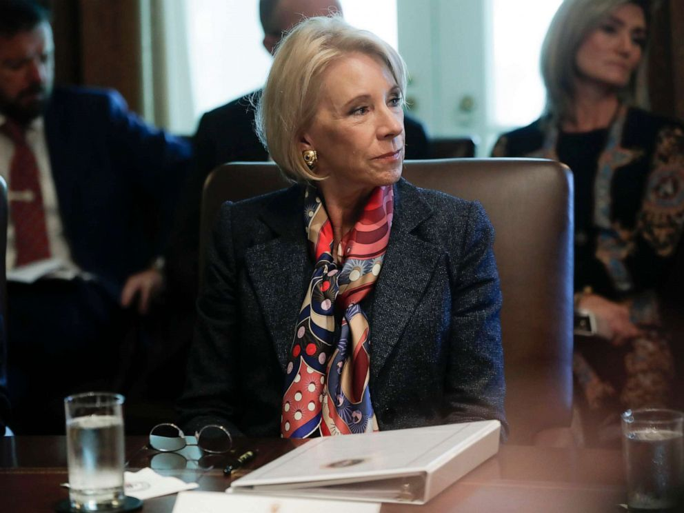 PHOTO: Education Secretary Betsy DeVos listens to President Donald Trump during a Cabinet meeting in the Cabinet Room of the White House in Washington, Oct. 21, 2019.