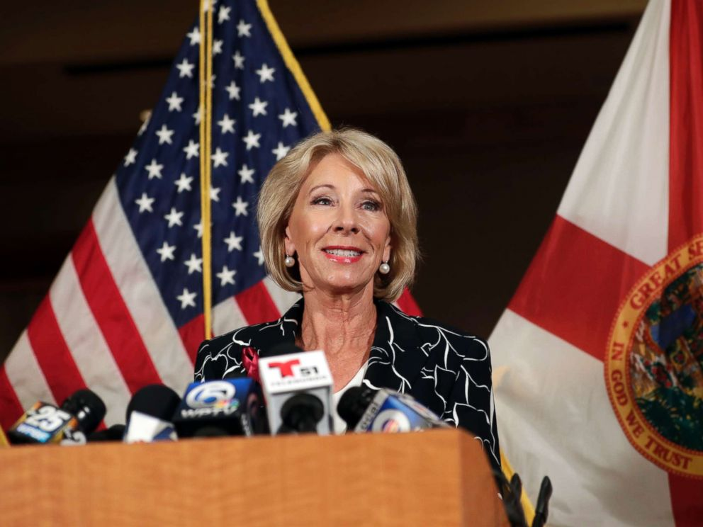 Betsy De Vos speaks at a news conference following a visit to Marjory Stoneman Douglas High School